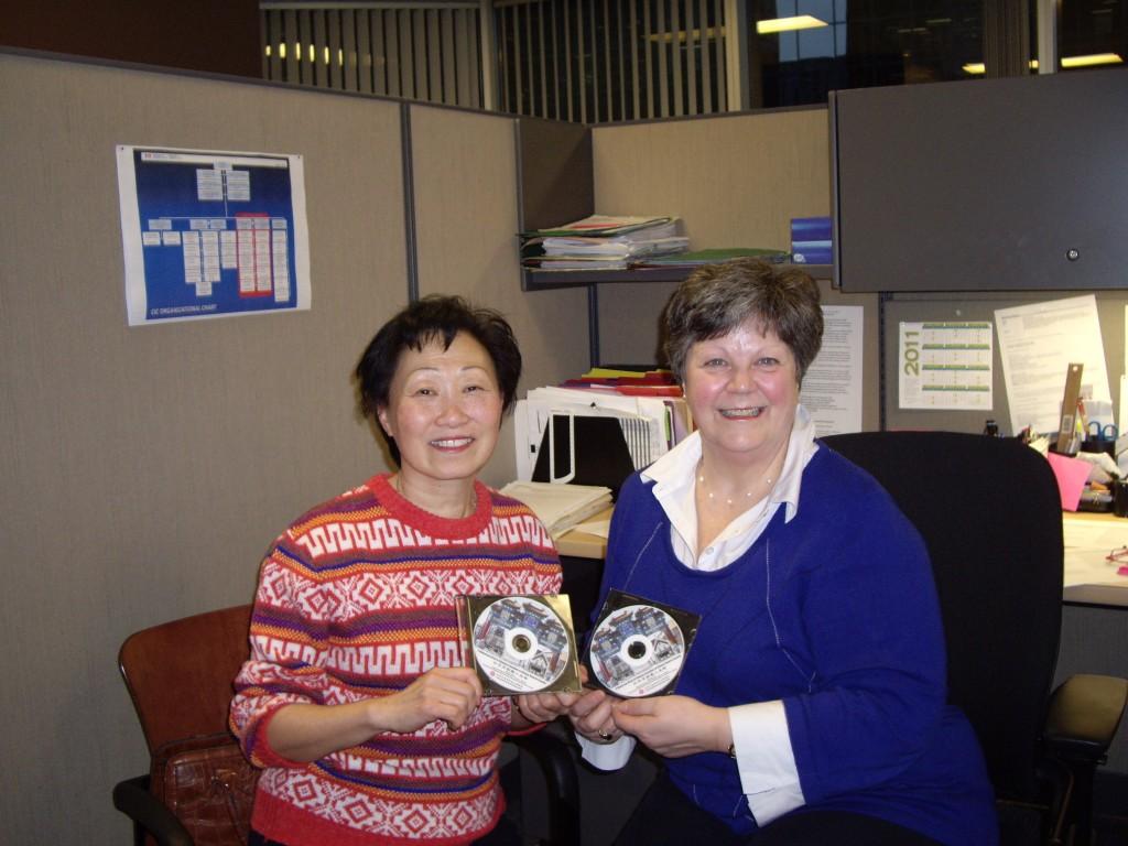 Helen Wong presents report CD to Ms. Rochefort